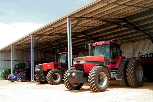 Two tractors parked in a shed