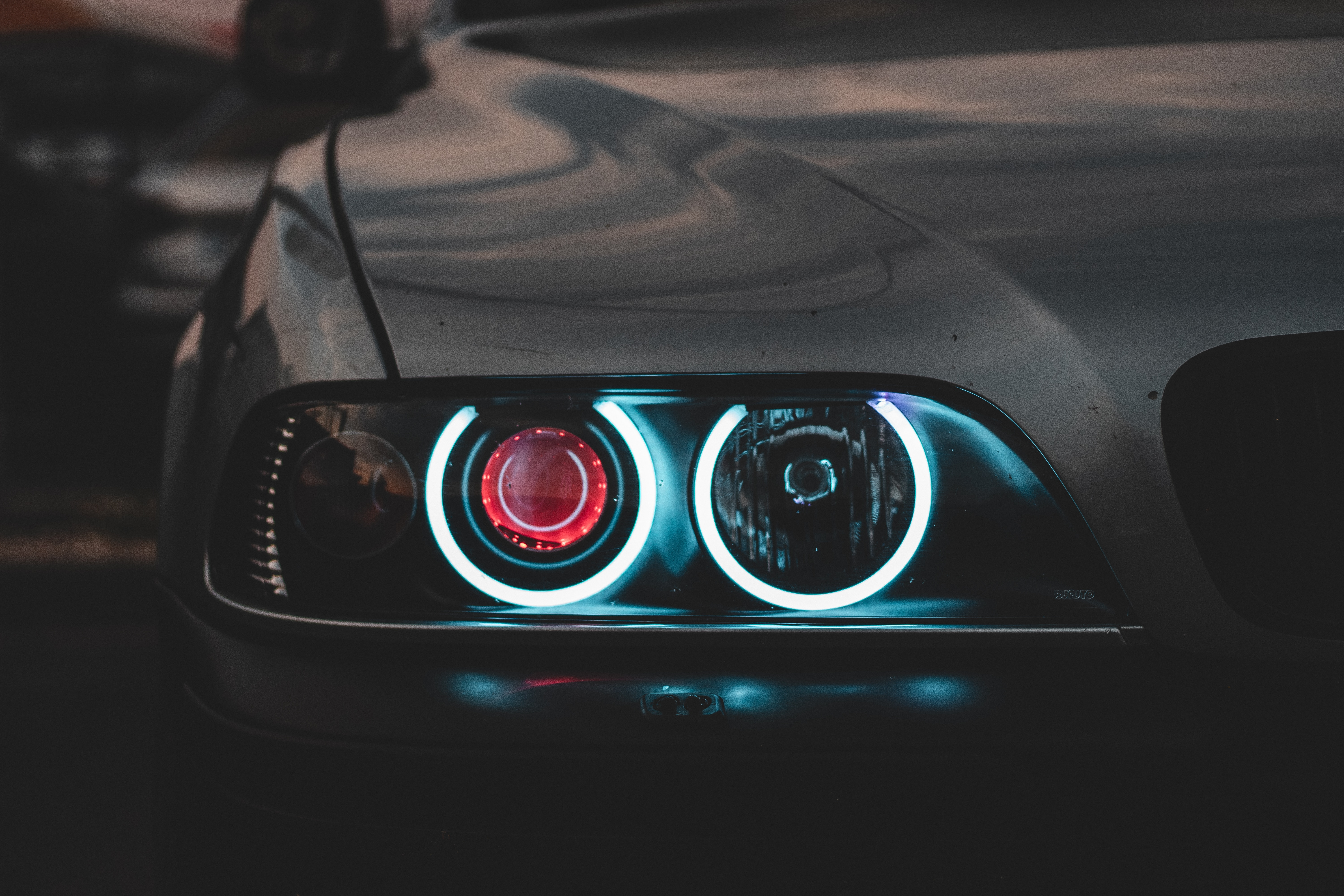 What is a Car Broker - Featured Image - Front Lights of an Executive Sedan
