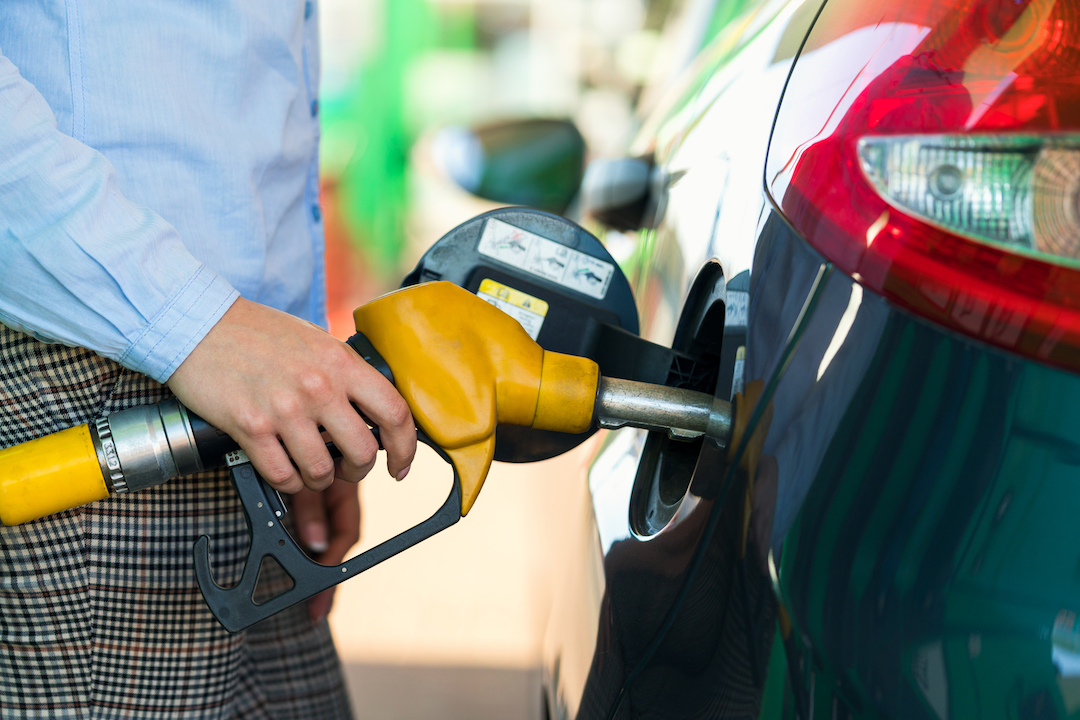 Man fills up fuel tank | Featured image for the most fuel efficient cars in Australia blog.